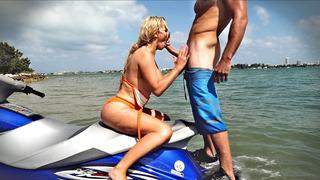 Nikki Benz sitting on her watercraft sucking his shaft