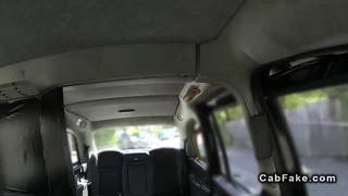 Busty blonde sucks big cock in a fake taxi