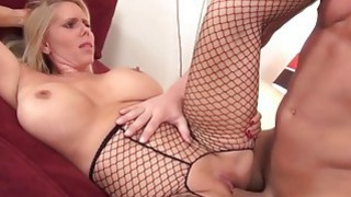 Milf in fishnet gets pleasure right on the bed