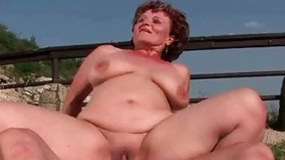 Fat granny loves a boy outdoor