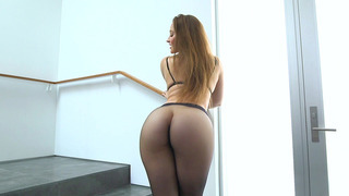 Dani Daniels posing in a sexy black pantyhose and high heels