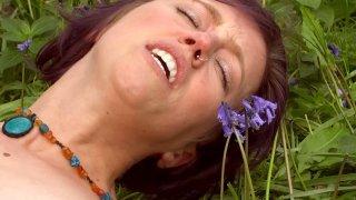 Self pleasure in a field of flowers
