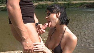 Brunette's lakeside lust