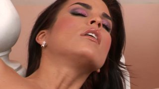 Charming brunette gal Nella treats her pussy with fingering