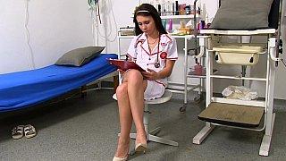 Slutty nurse spreading her pussy