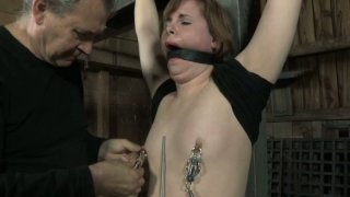Hefty slut Bronte gets her nipples squeezed badly. BDSM video