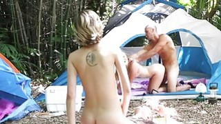 Two teen babes foursome in the camp site