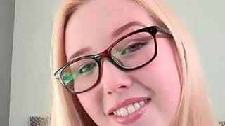 Blonde in glasses masturbates slick pussy