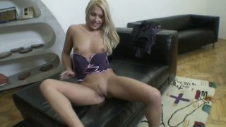 Perky blonde wench Brandy Smile pokes her wet twat with a fat dildo