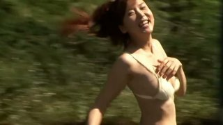 Tempting Japanese cutie China Fukunaga flashes her panties and bikini