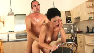 Flabby brunette MILF Inka rides Ryan's young cock on the floor