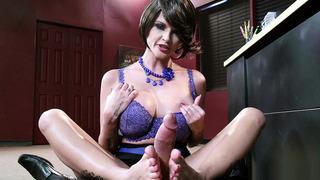 Joslyn James wanks a big dick with her feet