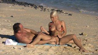 Naughty blonde Nesty gives handjob underwater