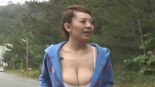 Bosomy Japanese diva Hitomi Tanaka wets her t shirt