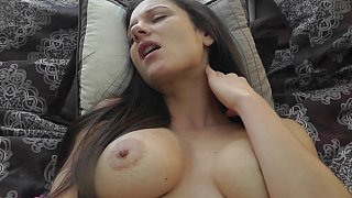 Busty brunette pleasuring herself